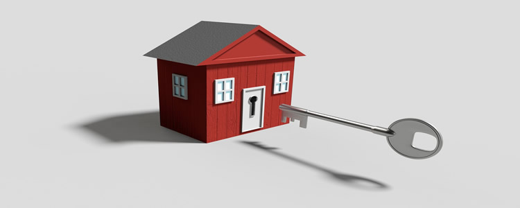 small red house being opened by a novelty key used for decorative purposes